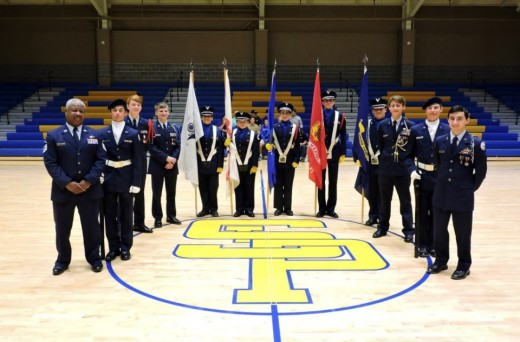 The St. Paul's JROTC Color Guard prepares to serve at the Veterans' Day assembly. (Photo by Karen Hebert)