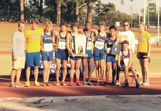 Cross Country team posing after winning state. (photo courtesy twitter)
