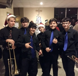 Members of the Jazz Band enjoy the reception following their concert in the cafeteria. (Photo by Lester Guttuso)