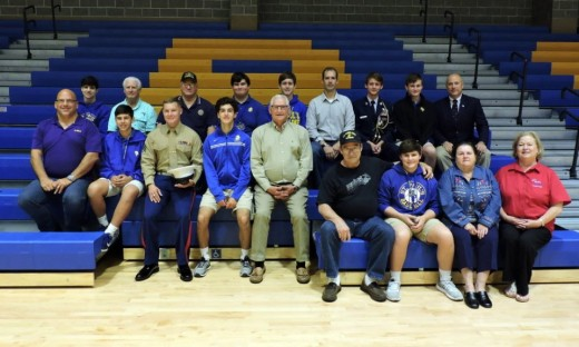 Members of St. Paul's alumni veterans unite with their St. Paul's student relatives.