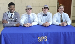 The four St. Pauls's seniors that signed celebrate their accomplishment (Photo by Karen Hebert)